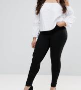 Vaqueros de tiro alto en negro limpio Sculpt Me Premium de ASOS DESIGN...