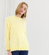 Jersey con cuello redondo texturizado en amarillo claro de Monki