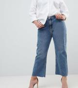 Vaqueros capri acampanados en tejido rígido con lavado medio vintage E...