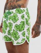 Pantalones cortos blancos con estampado de hojas y cintura elástica de...